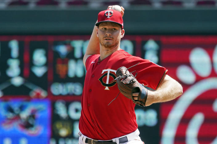 Minnesota Twins pitcher Bailey Ober throws against the Los Angeles Angels in the first inning of a baseball game, Sunday, July 25, 2021, in Minneapolis. (AP Photo/Jim Mone)