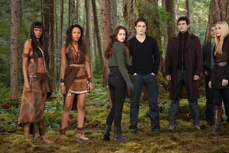 """This undated publicity photo released by Summit Entertainment shows, from left, Judith Shekoni, Tracey Heggins, Kristen Stewart, Robert Pattinson, Christian Camargo, Peter Facinelli and Casey LaBow in a scene from the film, """"The Twilight Saga: Breaking Dawn - Part 2."""" """"The Twilight Saga: Breaking Dawn - Part 2"""" led the Razzies lineup Wednesday, Jan. 9, 2013, with 11 nominations, including worst picture, lead-acting slots for Kristen Stewart and Robert Pattinson and supporting-acting nominations for Taylor Lautner and Ashley Greene. (AP Photo/Summit Entertainment, Andrew Cooper, SMPSP)"""