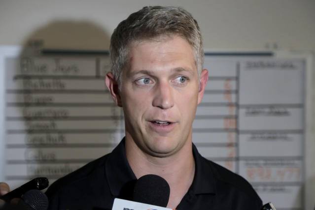 Baltimore Orioles general manager Mike Elias talks to reporters prior to a baseball game agianst the Toronto Blue Jays, Thursday, Aug. 1, 2019, in Baltimore. (AP Photo/Julio Cortez)