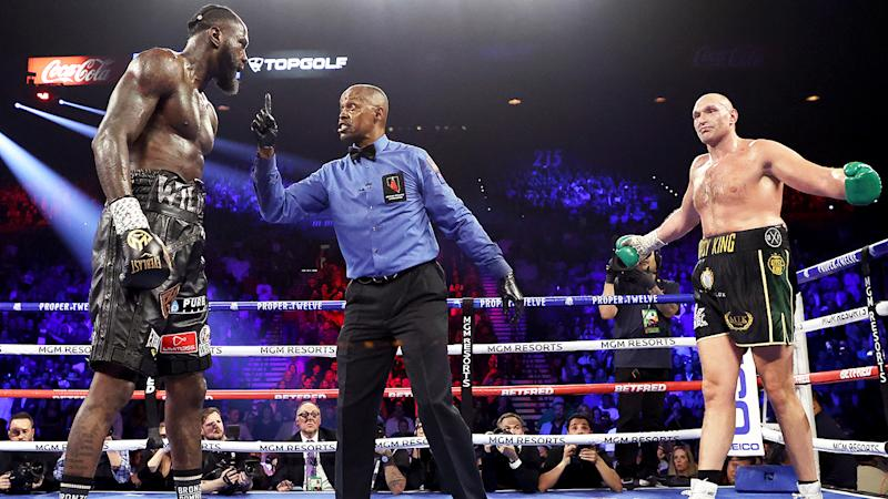 Referee Kenny Bayless, pictured here speaking to Deontay Wilder during his heavyweight bout against Tyson Fury.