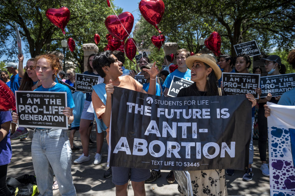 Opponents of abortion carrying signs like