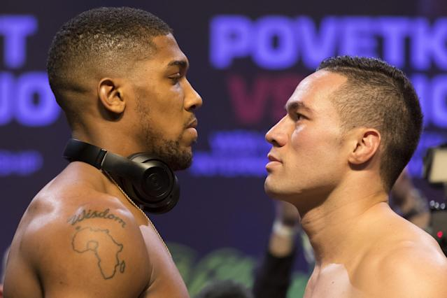 Anthony Joshua (L) and Joseph Parker weigh in at the Motorpoint Arena on Friday in Cardiff, Wales. (Getty Images)
