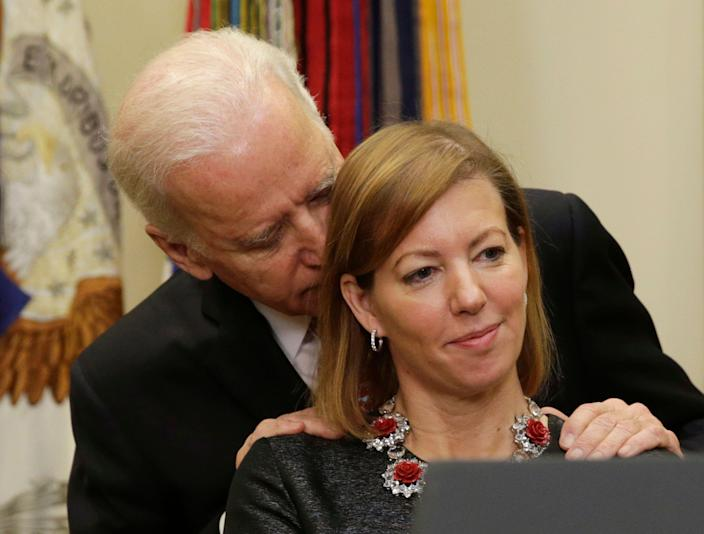 Vice President Joe Biden talks to Stephanie Carter as her husband, Ash Carter, (not pictured) delivers his acceptance speech as the new secretary of defense at the White House in Washington, D.C., Feb. 17, 2015. (Photo: Gary Cameron/Reuters)