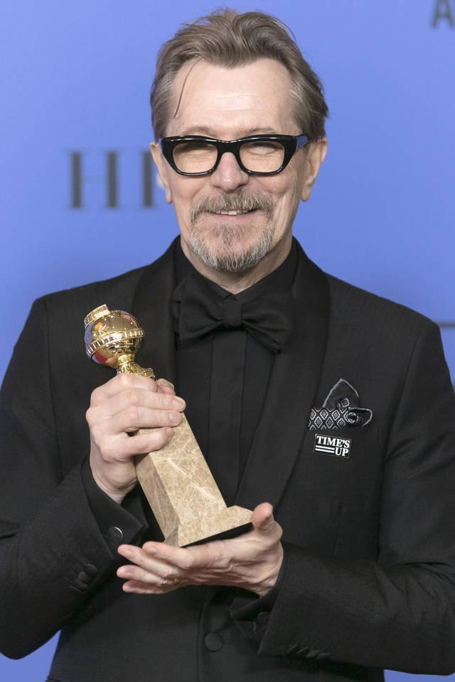 "Gary Oldman wore a ""Time's Up"" pin on his all-black ensemble but did not say a word from the podium about sexual inequality or harassment. (Photo: Getty Images)"