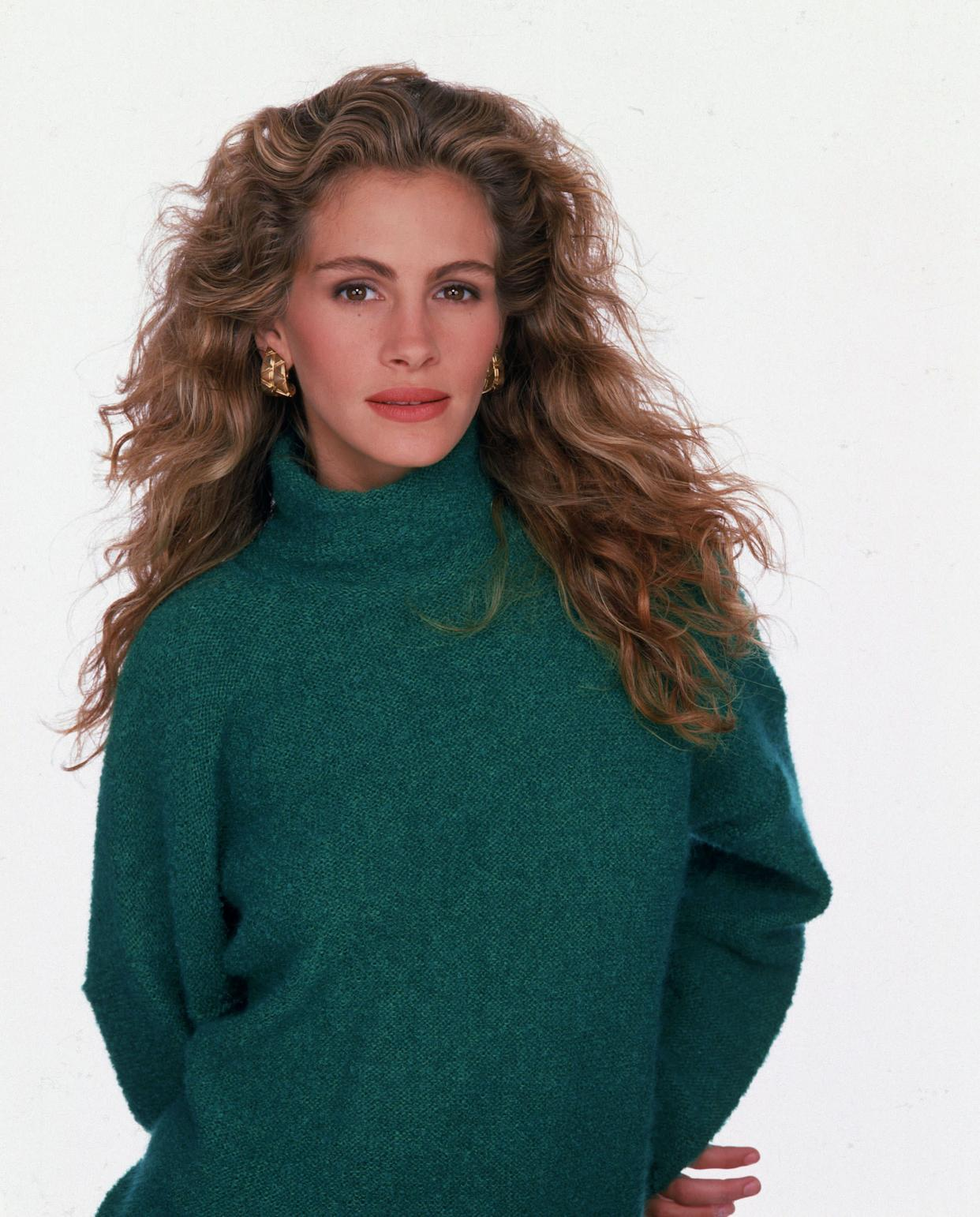 The actress poses in a green turtleneck for a studio portrait session in 1989.