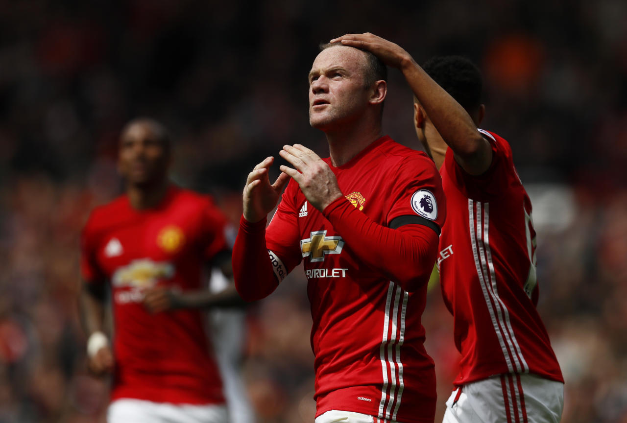 """Britain Football Soccer - Manchester United v Swansea City - Premier League - Old Trafford - 30/4/17 Manchester United's Wayne Rooney celebrates scoring their first goal  Action Images via Reuters / Jason Cairnduff Livepic EDITORIAL USE ONLY. No use with unauthorized audio, video, data, fixture lists, club/league logos or """"live"""" services. Online in-match use limited to 45 images, no video emulation. No use in betting, games or single club/league/player publications.  Please contact your account representative for further details."""