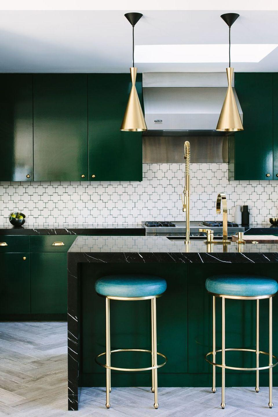 "<p>To bring contrast to this kitchen's daring cabinets and counters, Caitlin Murray of <a href=""http://www.blacklacquerdesign.com/"" rel=""nofollow noopener"" target=""_blank"" data-ylk=""slk:Black Lacquer Design"" class=""link rapid-noclick-resp"">Black Lacquer Design</a> opted for a modern geometric backsplash. </p>"