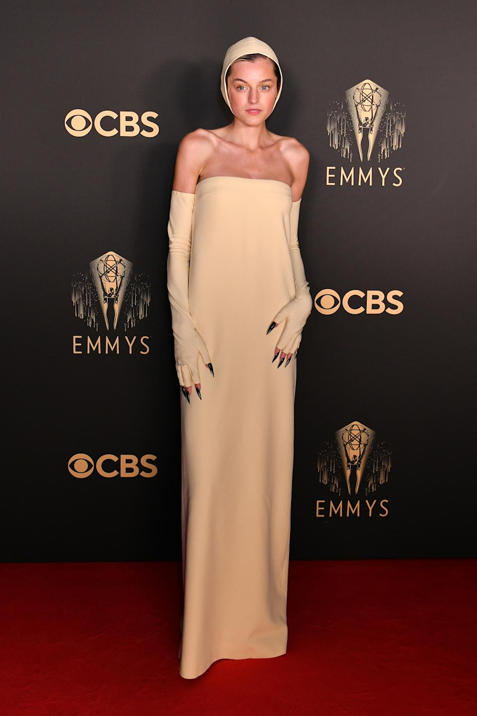 Emma Corrin wears a cream strapless column dress, long gloves and a bonnet at the Netflix celebration of the 73rd Emmy Awards at 180 The Strand on September 19, 2021 in London, England. (Photo by David M. Benett/Dave Benett/Getty Images for Netflix)
