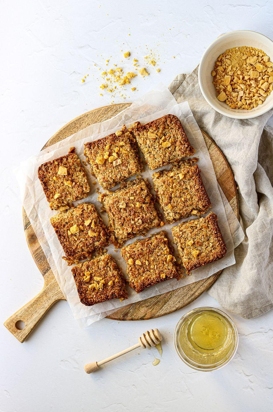 """<p>This classic <a href=""""https://www.delish.com/uk/cooking/recipes/a35487496/banana-flapjack/"""" rel=""""nofollow noopener"""" target=""""_blank"""" data-ylk=""""slk:flapjack"""" class=""""link rapid-noclick-resp"""">flapjack</a> recipe uses honey instead of golden syrup, but still super sweet, and super tasty. We've added <a href=""""https://www.delish.com/uk/cooking/recipes/a34503744/classic-honey-cake-recipe/"""" rel=""""nofollow noopener"""" target=""""_blank"""" data-ylk=""""slk:honeycomb"""" class=""""link rapid-noclick-resp"""">honeycomb</a> pieces for added texture, but leave out if you prefer. </p><p>Get the <a href=""""https://www.delish.com/uk/cooking/recipes/a35487495/flapjack-recipe-honey/"""" rel=""""nofollow noopener"""" target=""""_blank"""" data-ylk=""""slk:Classic Honey Flapjack"""" class=""""link rapid-noclick-resp"""">Classic Honey Flapjack</a> recipe</p>"""