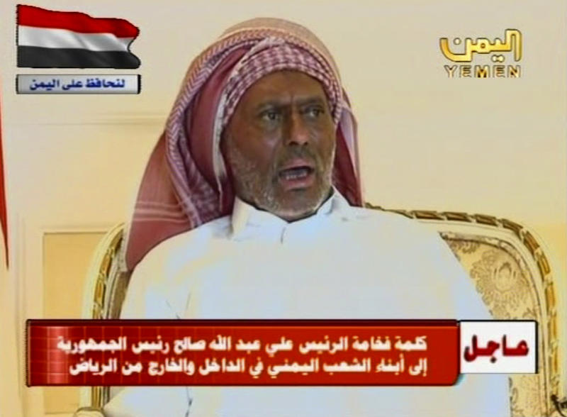 """In this video image taken from a prerecorded video and broadcast Thursday July 7, 2011 on Yemen state TV from Saudi Arabia, Yemen's embattled President Ali Abdullah Saleh lashed out  at opponents seeking to drive him from power in his first public appearance since he was injured last month in a blast at his palace compound. Sitting rigid in a chair, his hair covered with a cloth and his hands wrapped in white bandages, Ali Abdullah Saleh accused """"terrorist elements"""" of carrying out the June 3 attack and criticized his opponents for trying to topple him. He wore a white robe and his face appeared noticeable darker than before the attack.  (AP Photo/Yemen state TV)  NO ACCESS YEMEN"""