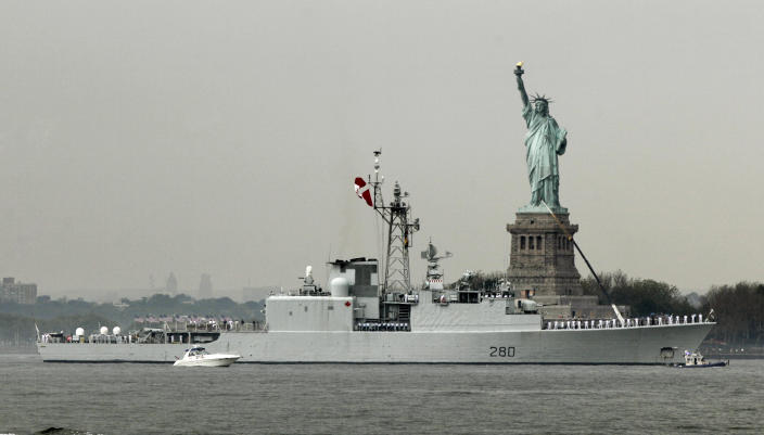 The HMCS Iroquois, from Canada, sails by the Statue Of Liberty, in New York, to participate in Fleet Week activities, Wednesday, May 23, 2012. (AP Photo/Richard Drew)