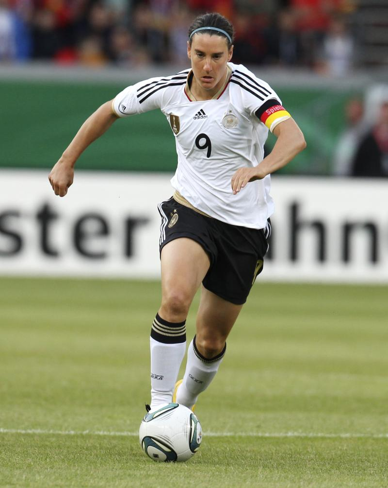 FILE - In this  June 16, 2011 file picture  Germany's Birgit Prinz controls the ball  during a women's test match between Germany and Norway in Mainz, Germany. Germany's football federation says former women's national team captain Birgit Prinz is retiring from the sport for good, ending a storied career that included two World Cup and five European titles. The DFB says the 33-year-old Prinz announced her full retirement to media on Friday Aug. 12, 2011. Prinz had already quit the national team after Germany's loss to Japan in this year's Women's World Cup.   (AP Photo/Michael Probst,File)