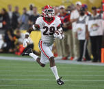 Georgia defensive back Christopher Smith returns an interception for a touchdown during the second quarter against Clemson in an NCAA college football game Saturday, Sept. 4, 2021, in Charlotte, N.C. (Curtis Compton/Atlanta Journal-Constitution via AP)