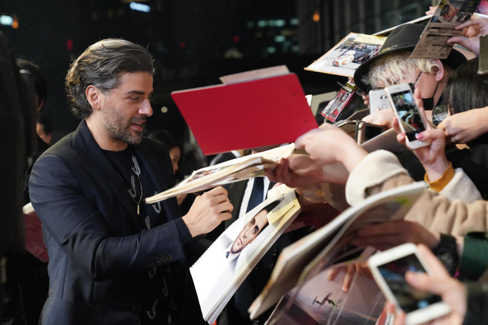 TOKYO, JAPAN - DECEMBER 11: Oscar Isaac signs autographs for fans at the special fan event for 'Star Wars: The Rise of Skywalker' at Roppongi Hills on December 11, 2019 in Tokyo, Japan. (Photo by Christopher Jue/Getty Images for Disney)