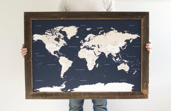 """<p>This map of the world doubles as artwork and a record of every place she's traveled: It comes with 100 push pins to mark the cities where she's touched down. Consider it her visual travel history. <em>(Navy World Map, from $205, <a rel=""""nofollow"""" href=""""https://www.etsy.com/listing/267450477/navy-world-map-reclaimed-wood-push-pin?mbid=synd_yahoostyle"""">Etsy</a>)</em></p>"""