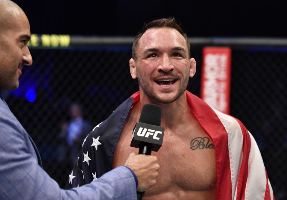 ABU DHABI, UNITED ARAB EMIRATES - JANUARY 23: Michael Chandler reacts after his knockout victory over Dan Hooker of New Zealand in a lightweight fight during the UFC 257 event inside Etihad Arena on UFC Fight Island on January 23, 2021 in Abu Dhabi, United Arab Emirates. (Photo by Jeff Bottari/Zuffa LLC)