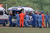 A body believed to be 15-year-old Irish girl Nora Anne Quoirin who went missing is brought into a ambulance in Seremban