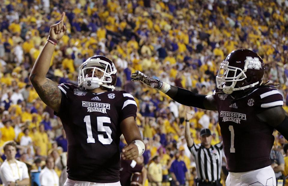 Mississippi State QB Dak Prescott (15) points to the sky after scoring a touchdown against LSU. (AP)
