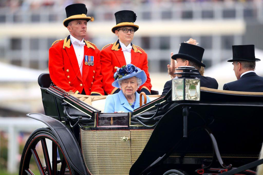 <p>Queen Elizabeth arrives at the first day of Royal Ascot in a traditional horse and carriage. </p>