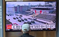 A man watches a television news broadcasting a file footage of a military parade showing North Korean soldiers and weapons, at a railway station in Seoul on October 10, 2020. - Nuclear-armed North Korea was expected to parade its latest and most advanced weapons through the streets of Pyongyang on October 10, as the coronavirus-barricaded country celebrated the 75th anniversary of leader Kim Jong Un's ruling party. (Photo by Jung Yeon-je / AFP) / The erroneous mention[s] appearing in the metadata of this photo by Jung Yeon-je has been modified in AFP systems in the following manner: changes dateline in IPTC metadata field to [Seoul] instead of [Pyongyang]. Please immediately remove the erroneous mention[s] from all your online services and delete it (them) from your servers. If you have been authorized by AFP to distribute it (them) to third parties, please ensure that the same actions are carried out by them. Failure to promptly comply with these instructions will entail liability on your part for any continued or post notification usage. Therefore we thank you very much for all your attention and prompt action. We are sorry for the inconvenience this notification may cause and remain at your disposal for any further information you may require. (Photo by JUNG YEON-JE/AFP via Getty Images)