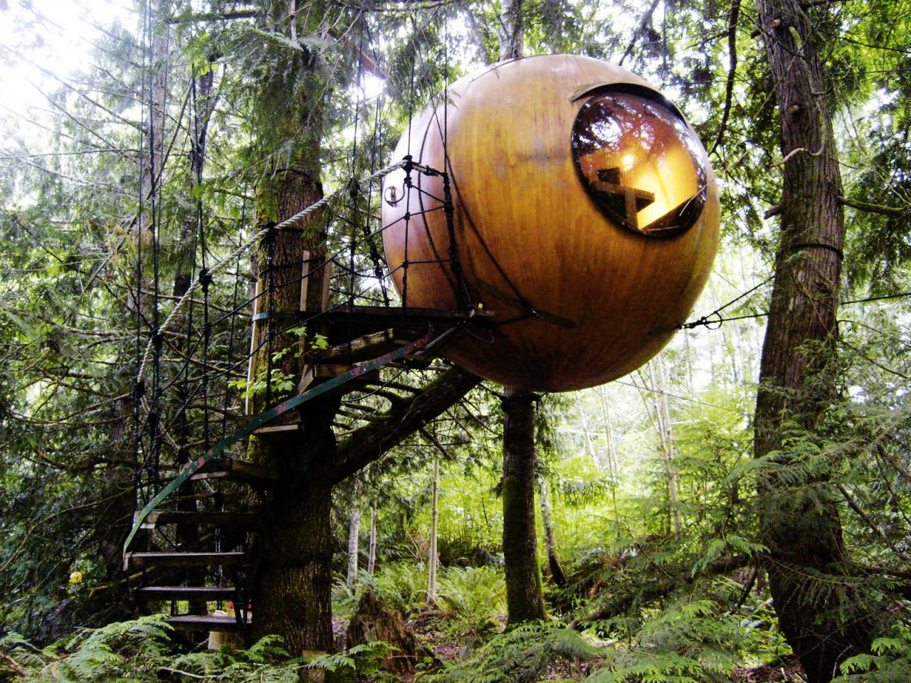 """<p>Dangling from dense conifers on British Columbia's Vancouver Island, these <a href=""""http://freespiritspheres.com"""">floating orbs</a>are made with the concept of """"oneness"""" in mind—the floor, walls, and ceiling create one continuous space, unlike your typical building. Taking cues from sailboat rigging, the spheres use trees as their suspension points and are tethered by three vertical ropes tied to tree branches. Guests can test out the spruce-and-yellow-cedar paneled rooms for $110 a night, or purchase a kit for building one in their own backyard. </p>"""