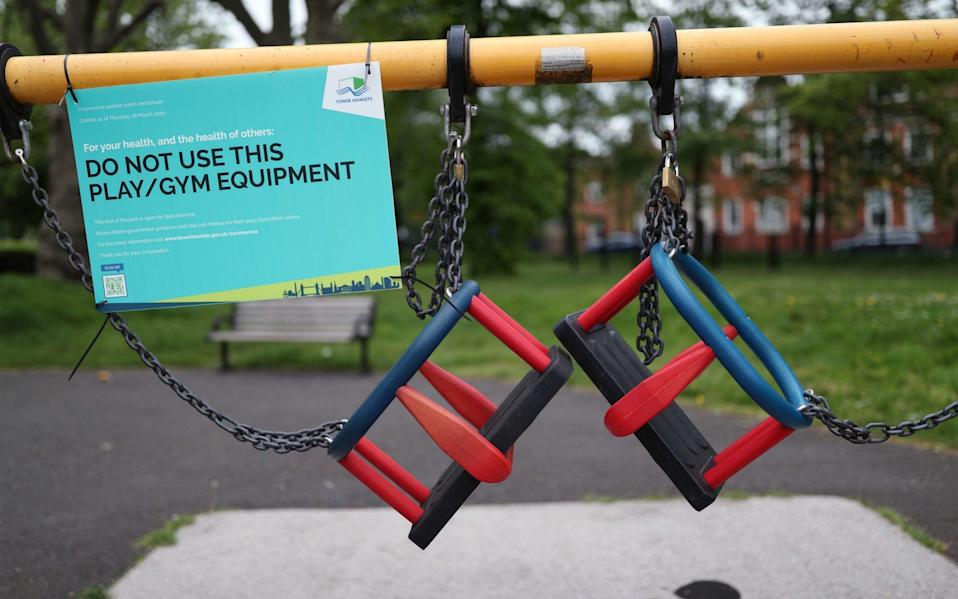 Activity equipment in the children's playground area of a park in London is closed off, as the UK continues in lockdown to help curb the spread of the coronavirus - Yui Mok/PA