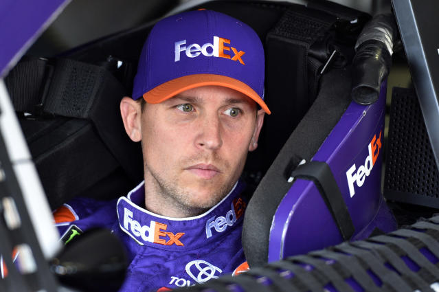 "<a class=""link rapid-noclick-resp"" href=""/nascar/sprint/drivers/1283/"" data-ylk=""slk:Denny Hamlin"">Denny Hamlin</a> sits in his car prior to practice for Sunday's NASCAR Cup Series auto race, Saturday, July 28, 2018, in Long Pond, Pa. (AP Photo/Derik Hamilton)"