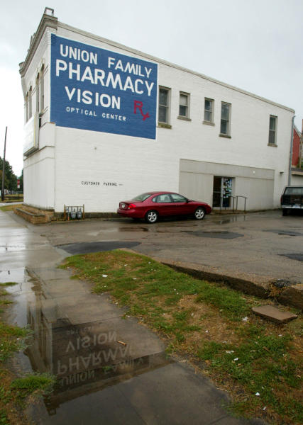 This Sept. 12, 2003 photo shows the Union Family Pharmacy in Dubuque, Iowa, which was closed after authorities found evidence that it had illegally dispensed drugs on the Internet. On Aug. 9, 2012, a federal judge in Iowa dropped a 2007 indictment against fugitive Miami doctor Armando Angulo, charged in a scheme to sell prescription drugs and launder money, in part because of the size of the case file. The Drug Enforcement Administration says the evidence starts with the Dubuque raid that eventually secured the conviction of 26 defendants, including 19 doctors, in federal court in Iowa. The investigation dismantled two Internet pharmacies that illegally sold 30 million pills to customers. (AP Photo/Telegraph Herald, Dave Kettering)