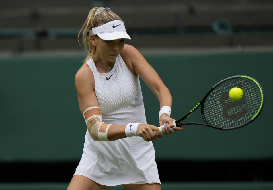Britain's Katie Boulter plays a return to Belarus's Aryna Sabalenka during the women's singles second round match on day three of the Wimbledon Tennis Championships in London, Wednesday June 30, 2021. (AP Photo/Alastair Grant)