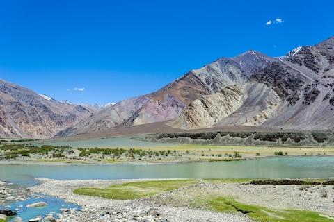 Colorful rock formations are seen along the Indus river - Credit: GEtty