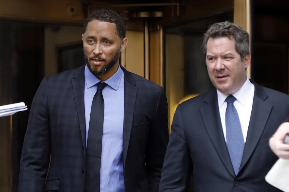 FILE - Former assistant basketball coach for the University of Southern California Tony Bland, left, and his attorney Jeffrey Lichtman, leave federal court in New York, in this Wednesday, June 5, 2019, file photo. The NCAA hit Southern California's men's basketball program with two years' probation and a $5,000 fine as the result of a former assistant who violated NCAA ethical conduct rules when he accepted a bribe to steer players to a business management company. The Division I Committee on Infractions on Thursday, April 15, 2021, announced the penalties, which include a 1% loss of the school's basketball budget. The probation runs until April 14, 2023. Tony Bland, the former associate head under coach Andy Enfield, wasn't mentioned by name in the NCAA report. (AP Photo/Richard Drew, FIle)