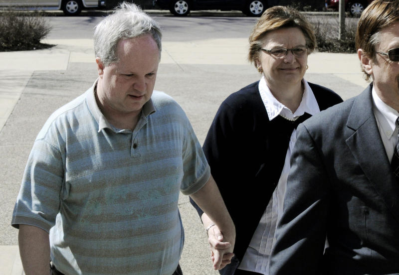 FILE - In this May 4, 2011, file photo, William Melchert-Dinkel arrives at the Rice County Courthouse in Faribault, Minn., with his wife, Joyce, for his sentencing. The attorney for the ex-nurse found guilty of encouraging the suicides of a Canadian woman and a British man is asking the Minnesota Court of Appeals to overturn his conviction of aiding the suicides on free speech grounds.  (AP Photo/Jim Mone, File)