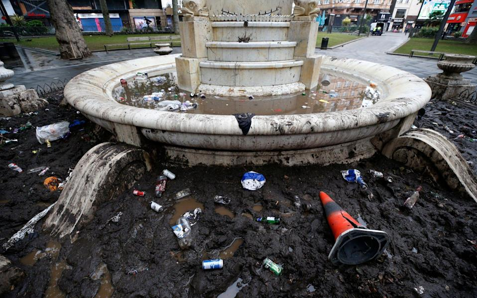 Rubbish left by football fans floating the fountain at Leicester Square on June 19, 2021 in London, England. England and Scotland drew 0-0 in the Euro 2020 match at Wembley - GETTY IMAGES