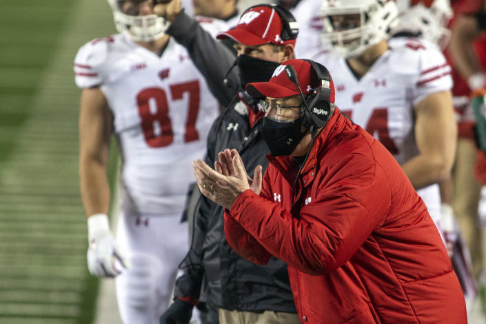 Wisconsin coach Paul Chryst cheers on his players from the sideline during the first quarter of the team's NCAA college football game against Michigan in Ann Arbor, Mich., Saturday, Nov. 14, 2020. (AP Photo/Tony Ding)