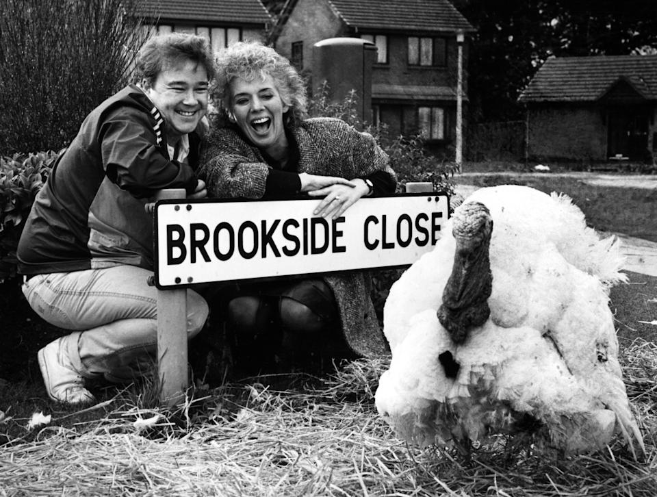 Michael stark and Sue Johnston from the Brookside cast with Trevor the Turkey. 6th November 1985. (Photo by Staff/Mirrorpix/Getty Images)