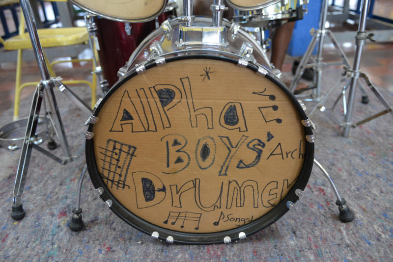 In this Feb. 17, 2014 photo, a cardboard cutout is shown displayed on the bass drum of the band's kit at the Alpha Boys' School, a residential vocational school in Kingstom, Jamaica. The school has been a cornerstone of Jamaica's prolific musical culture for over a century, producing numerous musicians who have taken the homegrown musical genres of ska, rocksteady and reggae to the world. At the school, students between 8 and 18 are taught to read music and understand harmony and composition, if they don't focus on the school's more traditional trades like woodworking and tailoring. (AP Photo/David McFadden)