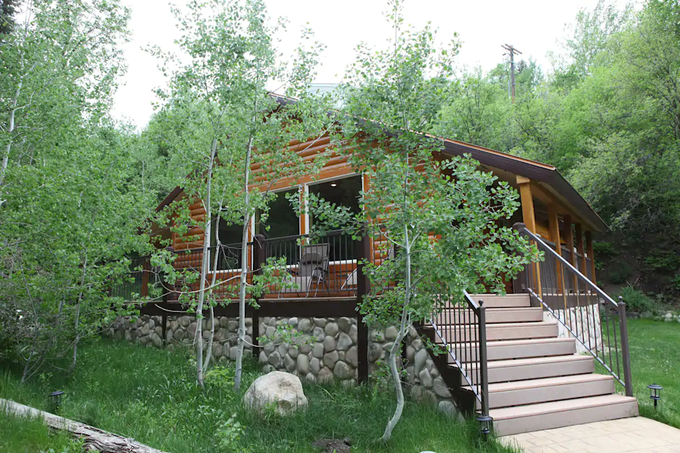 """<h2>Sundance, Utah<br></h2><br><strong>Location:</strong> Sundance, Utah<br><strong>Sleeps:</strong> 4<br><strong>Price Per Night:</strong> <a href=""""http://airbnb.pvxt.net/do92Oj"""" rel=""""nofollow noopener"""" target=""""_blank"""" data-ylk=""""slk:$301"""" class=""""link rapid-noclick-resp"""">$301</a><br><br>""""Enjoy the smell of pine trees, fresh air, and the sound of the Provo river rushing only a few feet from the large front balcony.<br><br>Our intimate 2 bedroom, 1 bath cabin is perfectly sized for a couple's retreat or family vacation to the Conde Nast award-winning resort. Bedroom 1 includes a king-size bed and bedroom 2, a queen-size bed. The living area is comfortable and spacious. The kitchen features quality appliances and granite countertops. Cooking ware, dishes, and utensils provided."""" <br><br><h3>Book <a href=""""http://airbnb.pvxt.net/do92Oj"""" rel=""""nofollow noopener"""" target=""""_blank"""" data-ylk=""""slk:Sundance Streamside Cozy Two Bedroom Hot Tub Cabin"""" class=""""link rapid-noclick-resp"""">Sundance Streamside Cozy Two Bedroom Hot Tub Cabin</a></h3>"""