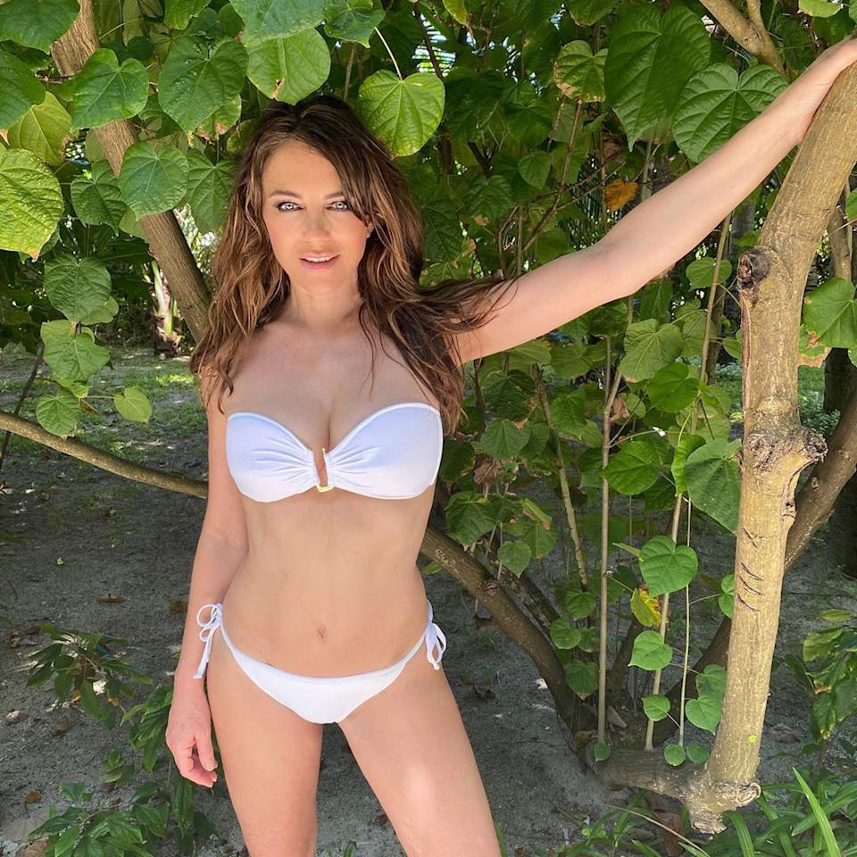 """<p>The """"glorious Maldives"""" served as the backdrop of the star's fun photo session, where she modeled a strapless white bikini top and string bottoms from her <a href=""""https://www.elizabethhurley.com/"""" target=""""_blank"""" rel=""""nofollow"""">namesake line</a>.</p>"""