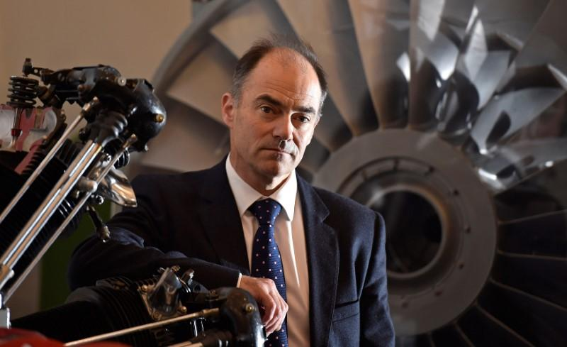 FILE PHOTO: Warren East, CEO of Rolls-Royce, poses for a portrait in front of a Pegasus airplane engine at the company's aerospace engineering and development site in Bristol, Britain, December 17, 2015. REUTERS/Toby Melville/File Photo