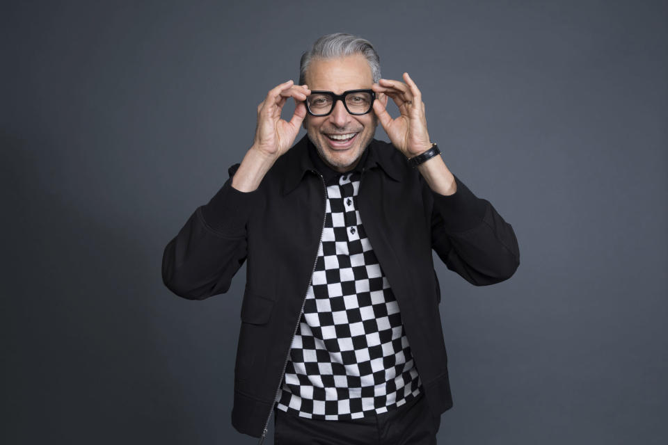 """FILE - Jeff Goldblum poses at the Disney + launch event promoting """"The World According to Jeff Goldblum"""" on Oct. 19, 2019, in West Hollywood, Calif. Goldblum turns 69 on Oct. 22. (Photo by Mark Von Holden/Invision/AP, File)"""