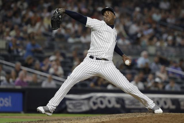 New York Yankees' Aroldis Chapman delivers a pitch during the ninth inning of a baseball game against the Cleveland Indians, Friday, Aug. 16, 2019, in New York. (AP Photo/Frank Franklin II)