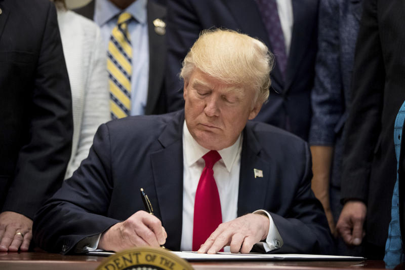 Trump says US won't leave NAFTA _ for now