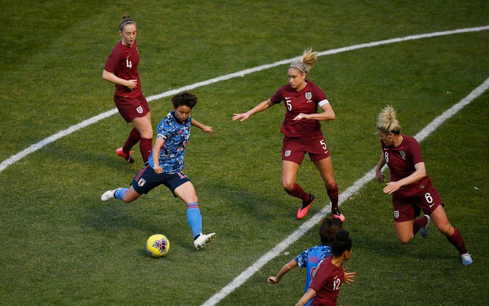 Mina Tanaka #15 of Japan dribbles the ball as Steph Houghton #5 and Millie Bright #6 of England defend during the first half in the SheBelieves Cup at Red Bull Arena on March 08, 2020 - England Women will not enter 2021 SheBelieves Cup, FA confirms - GETTY IMAGES