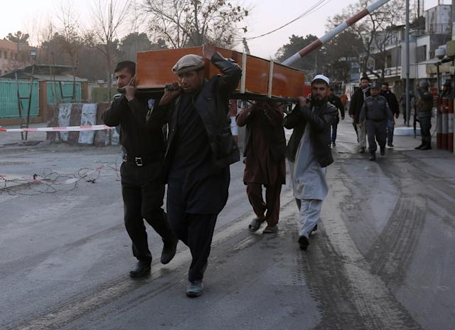<p>Men carry a victim's casket at the site of a car bomb attack in Kabul, Afghanistan , Jan. 27, 2018. (Photo: Omar Sobhani/Reuters) </p>