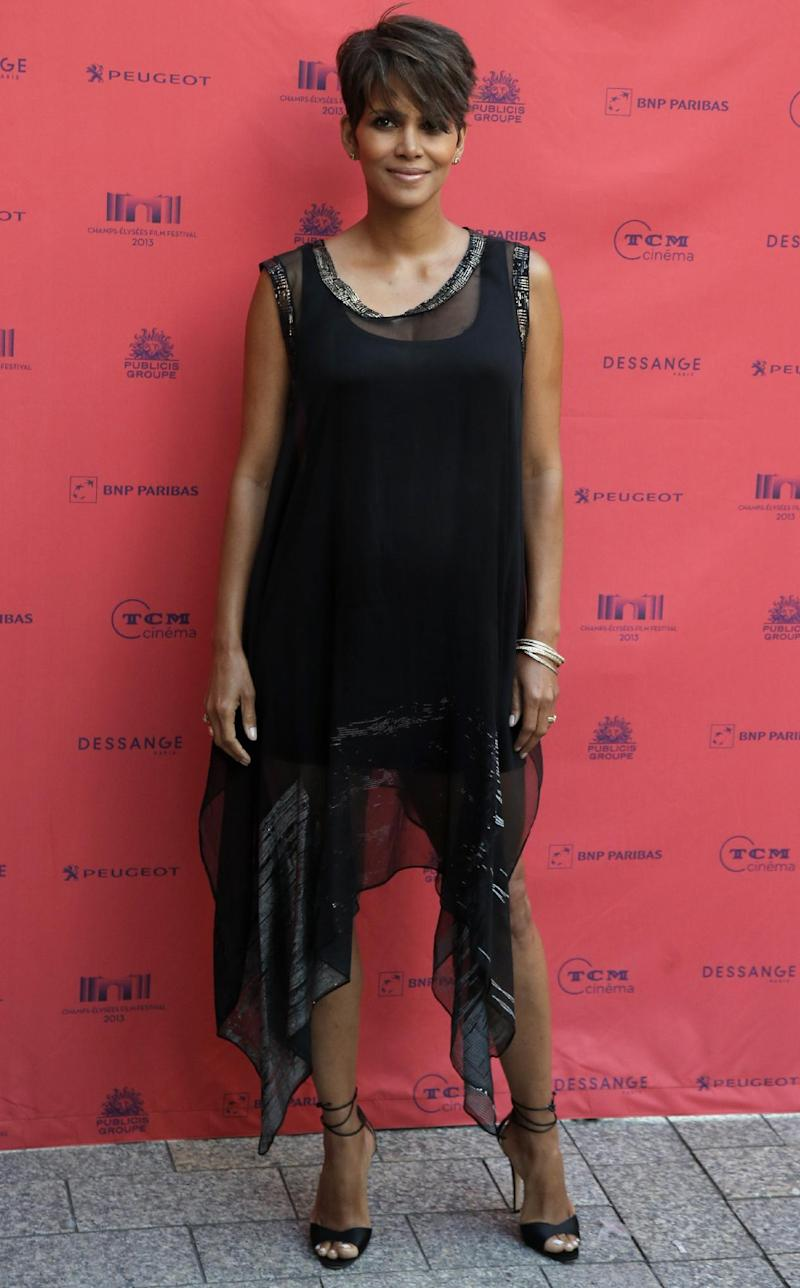 """FILE - In this June 13, 2013 file photo, actress Halle Berry arrives at the screening of the film """"Things we Lost in the Fire"""" with the french title """"Nos Souvenirs Brules"""" during the Champs-Elysees Film Festival, at the """"Publicis Cinema"""" in Paris. CBS says Berry will star in a serialized drama coming to the network next summer. The Oscar-winning actress will headline """"Extant,"""" a 13-episode thriller. (AP Photo/Francois Mori, File)"""