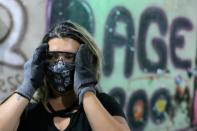 Rage Room, a place where people can destroy objects to vent fury, opens up in Sao Paulo