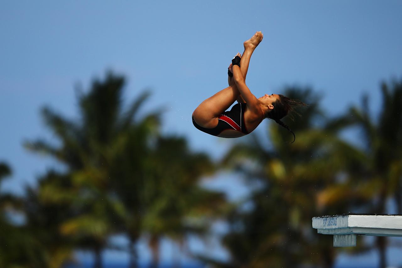 FORT LAUDERDALE, FL - MAY 11:  Meaghan Benfeito of Canada dives during the Womens 10m Platform Semi Final at the Fort Lauderdale Aquatic Center on Day 2 of the AT&T USA Diving Grand Prix on May 11, 2012 in Fort Lauderdale, Florida.  (Photo by Al Bello/Getty Images)