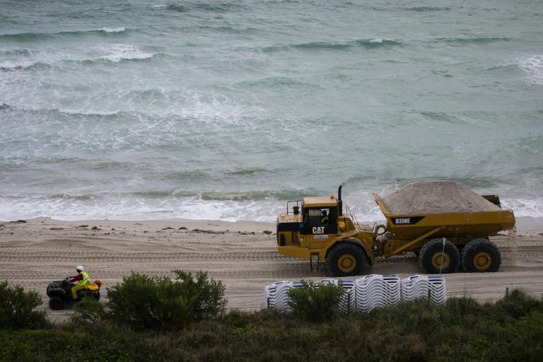 Every day from January 17, 2020 until June, trucks will tip between 100 and 250 loads, each containing 22 tons of sand, onto Miami beach (AFP Photo/Eva Marie UZCATEGUI)