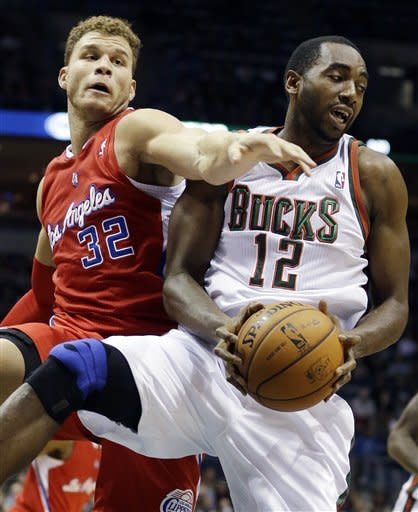 Milwaukee Bucks' Luc Richard Mbah a Moute (12) and Los Angeles Clippers' Blake Griffin (32) battle for a rebound during the first half of an NBA basketball game Saturday, Dec. 15, 2012, in Milwaukee. (AP Photo/Morry Gash)