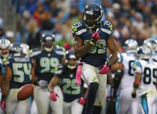 Seattle Seahawks' Brandon Browner (39) reacts after recovering a Carolina Panthers fumble during the third quarter of an NFL football game in Charlotte, N.C., Sunday, Oct. 7, 2012. (AP Photo/Bob Leverone)